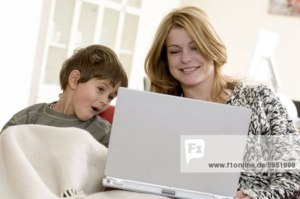 Mother and her son using a laptop. Mother and her son using a laptop