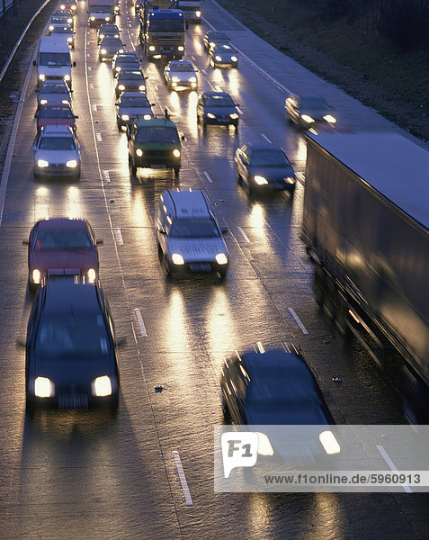 Traffic on wet motorway at dusk  United Kingdom  Europe