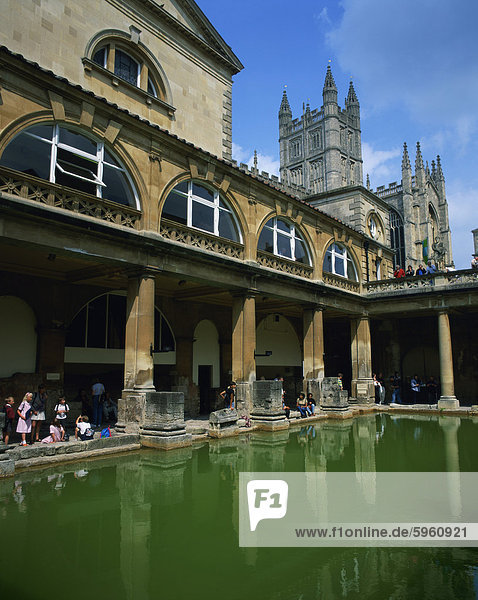 Visitors in the Roman Baths  with the Abbey beyond in Bath  UNESCO World Heritage Site  Avon  England  United Kingdom  Europe