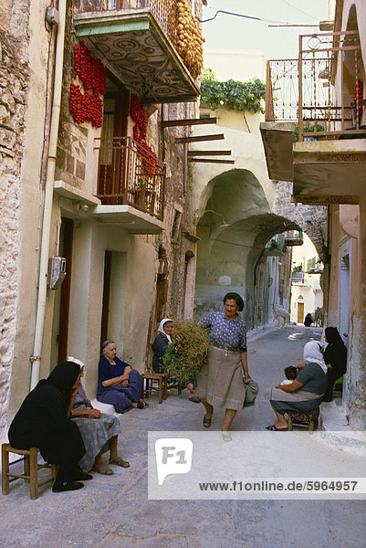 Women gathering on the doorsteps in the early evening  along the narrow back streets of the old mastic village of Pyrgi  Chios  North Aegean Islands  Greek Islands  Greece  Europe