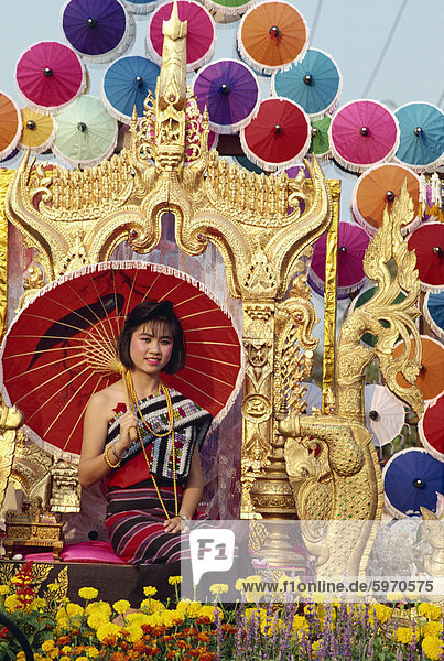 Portrait of a woman with umbrella seated on a golden throne in a parade in Chiang Mai  Thailand  Southeast Asia  Asia