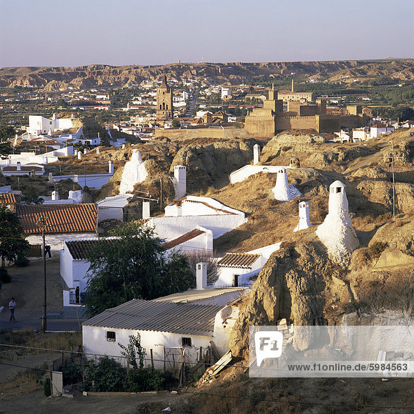 Cave dwellings and town from the suburb  Barrida des Cuevas  Guadix  Andalucia  Spain  Europe