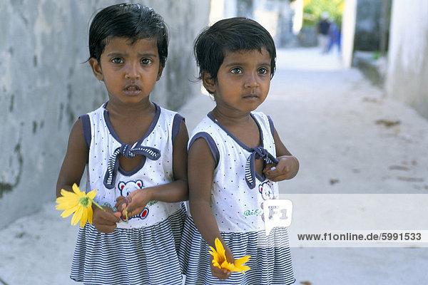 Portrrait of two little girls  Dharavandu Island  Baa Atoll  Maldives  Asia