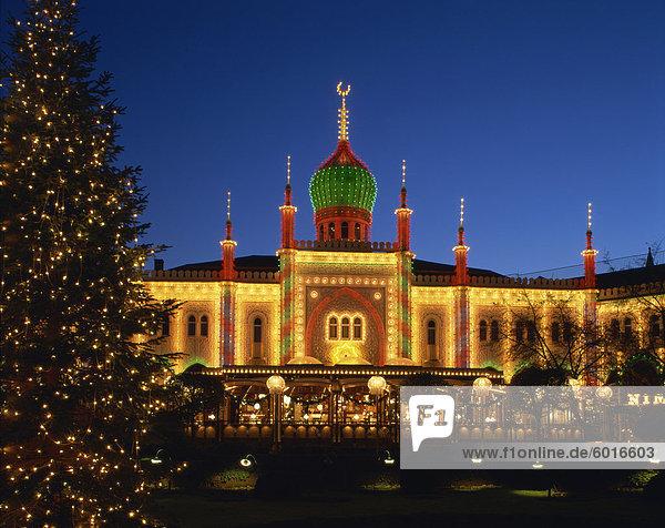 Illuminated Christmas tree and the Pavilion at dusk  Tivoli Gardens  Copenhagen  Denmark  Scandinavia  Europe