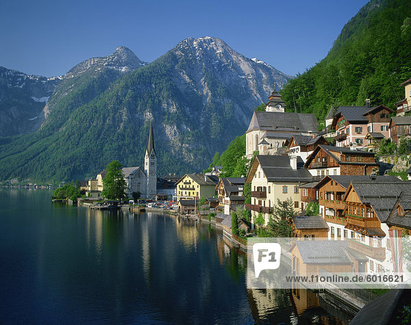 Houses  chalets and the church of the village of Hallstatt beside the lake  in morning light  UNESCO World Heritage Site  near Salzburg in the Salzkammergut  Austria  Europe