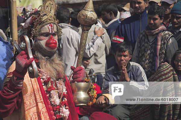Man dressed as Hanuman  the Hindu monkey God  entertains people at Shivaratri festival  Pashupatinath Temple  Kathmandu  Nepal  Asia