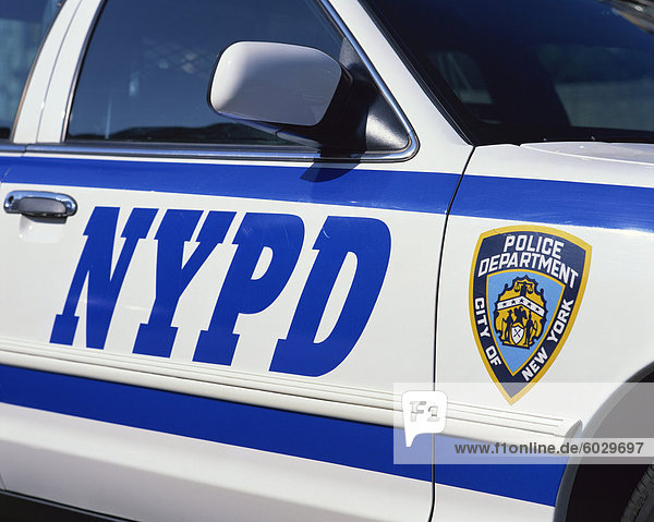 Close-up of police car with insignia of the City of New York Police Department  NYPD  on the side  in New York  United States of America  North America
