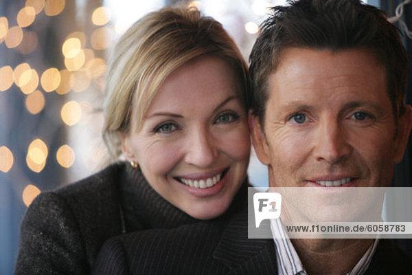 Close-up of mature couple looking at camera
