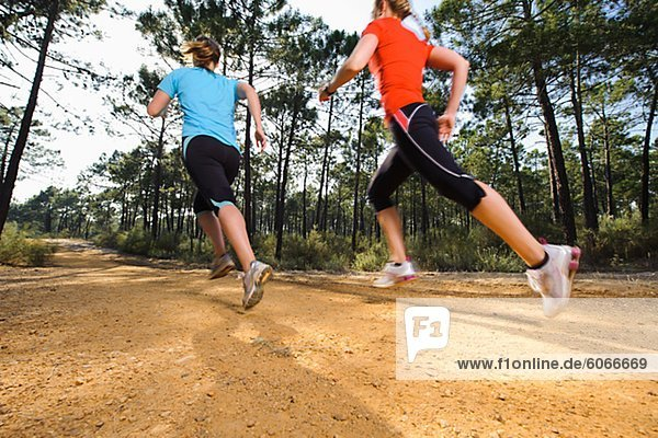 Young women jogging  low angle view