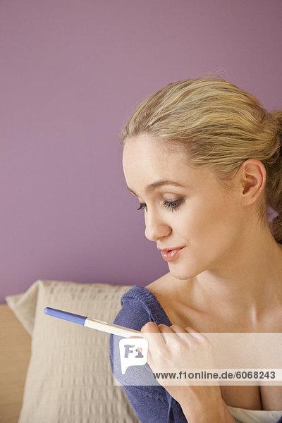 Woman making pregnancy test