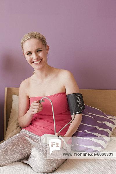 Woman measuring blood preasure