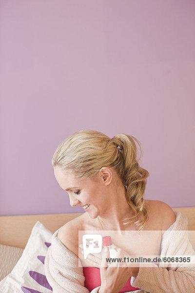 Woman applying herbal medicine