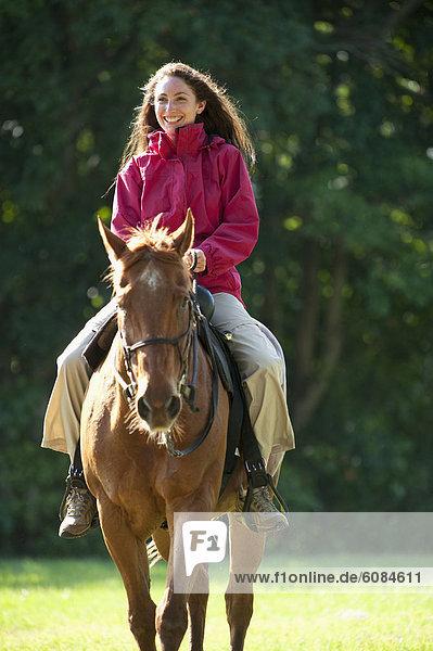 Frau  fahren  reiten - Pferd  Florida