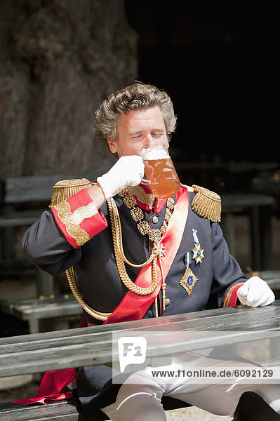 Germany  Man as King Ludwig of Bavaria drinking beer