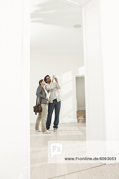 Germany  Berlin  Mature couple inspecting new house