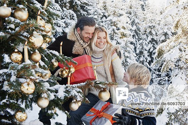 Austria  Salzburg County  Family celebrating christmas in snow