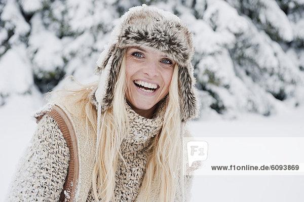 Austria  Salzburg County  Mid adult woman smiling  portrait