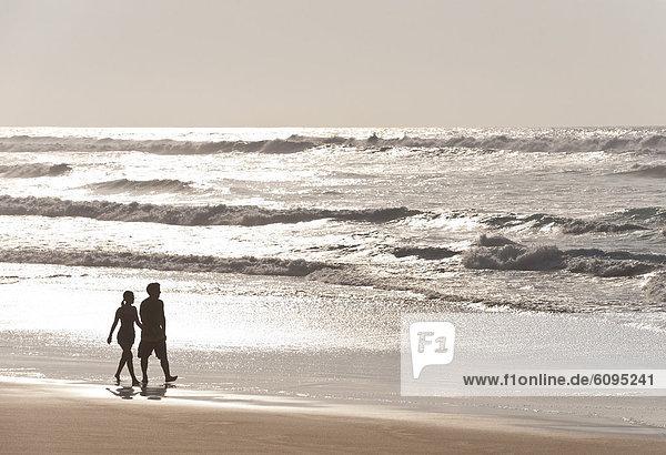 Portugal  Couple walking on beach