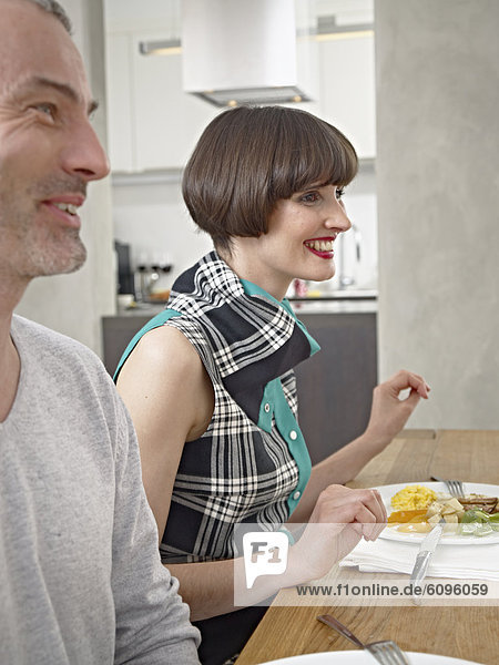 Man and woman having dinner  smiling