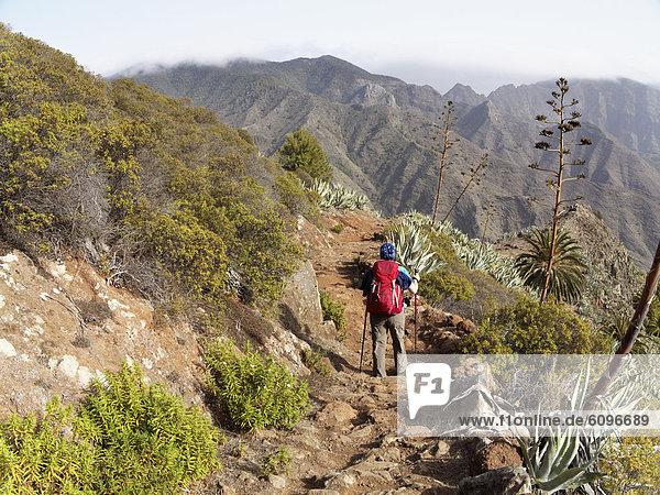 Spain  La Gomera  Woman hiking at Barranco de la Laja