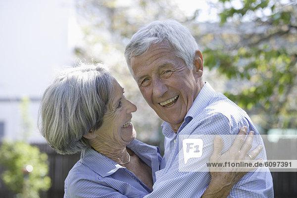 Germany  Bavaria  Senior couple smiling  close up