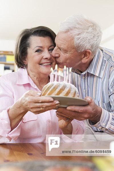 Senior man and woman celebrating birthday