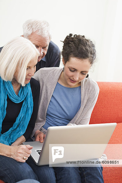 Man and women watching pictures on laptop
