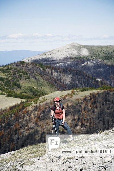 A woman walks on a broad ridge in the southern Chilcotin mountains.