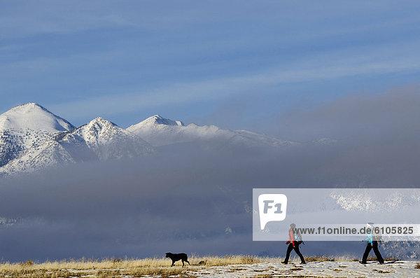 Two women hiking in the Sierra Foothills outside of Lake Tahoe  California.
