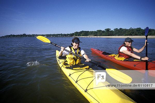 Two women sea kayaking  Chesapeake Bay  Maryland