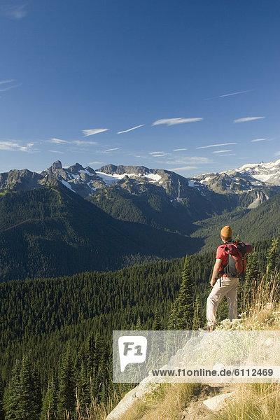Young man hiking in Mount Rainier.