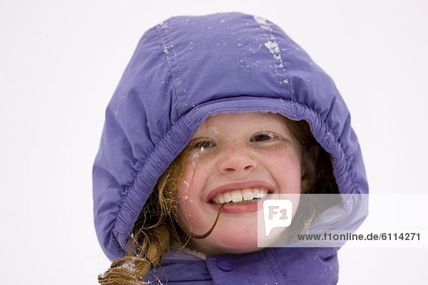 Portrait of young girl Cross Country Skiing in Dayton  Maine.