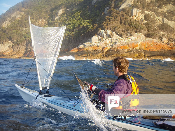 Sea-kayaker under sail,  Bass Strait,  Australia