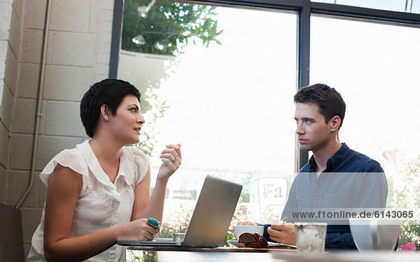 Businesspeople in cafe with laptop