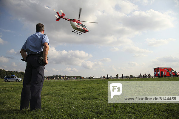 Air ambulance in action  after sustaining severe burns  a 15-year-old girl is flown by rescue helicopter from Tempelhof Field to the Berlin Unfallkrankenhaus  A&E hospital  Berlin  Germany  Europe