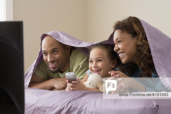 African family watching television