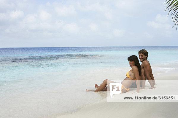 sitzend  Strand  Südamerika