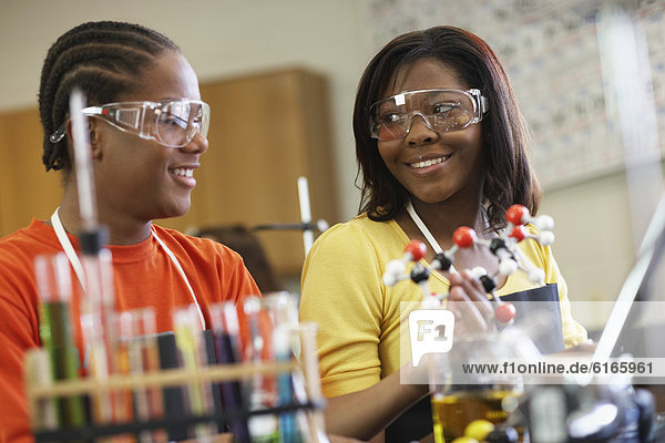 African American teenagers in science class