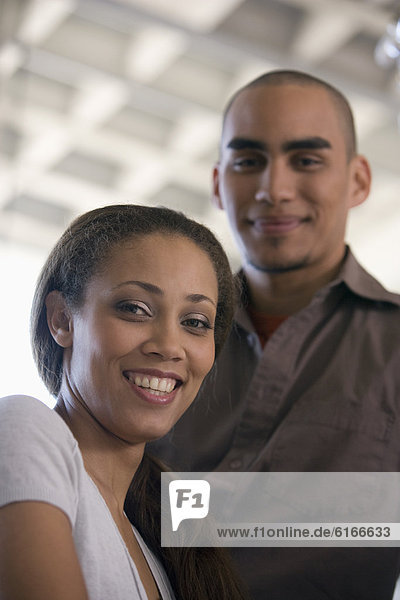 African American woman with boyfriend in background
