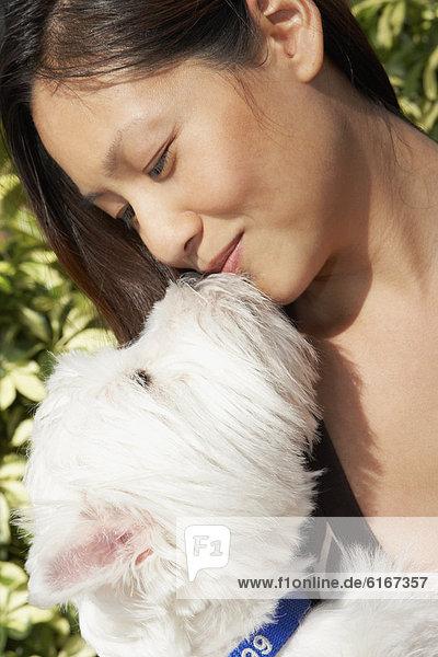 Frau  küssen  Hund Frau ,küssen ,Hund