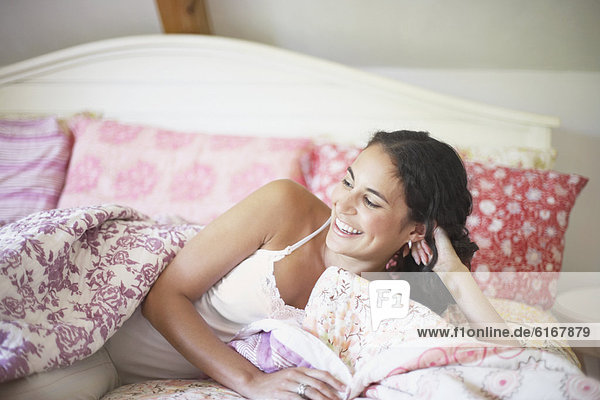 Young woman relaxing on her bed