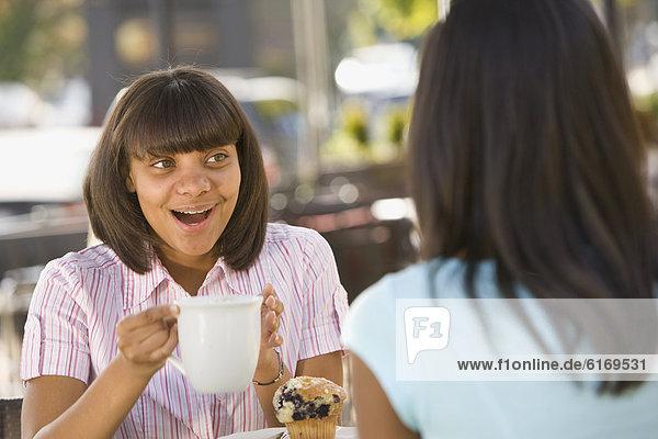 African teenaged girl talking to friend