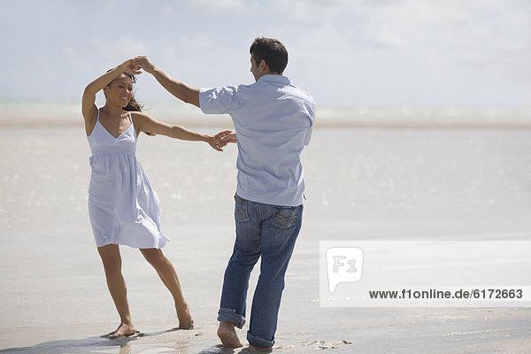 Strand  Hispanier  tanzen