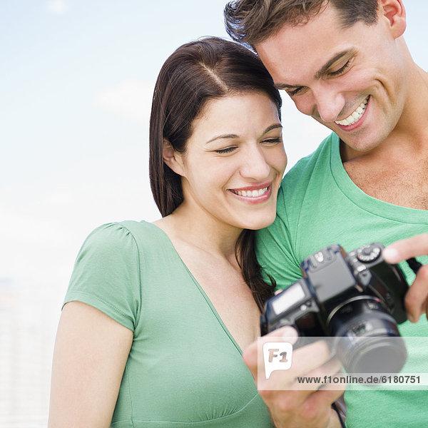 Zusammenhalt  sehen  lächeln  Blick in die Kamera