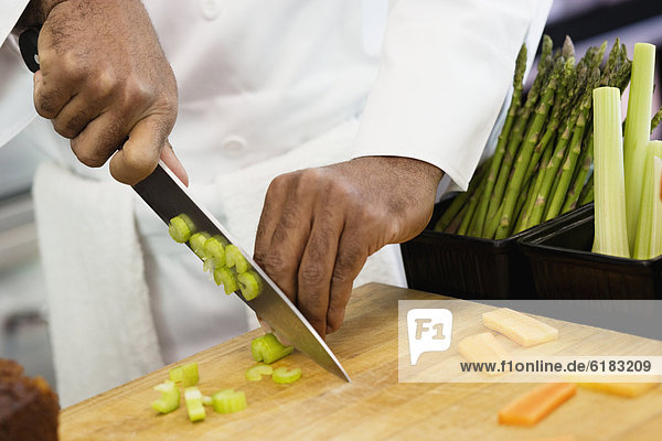 Close up of chef chopping vegetables