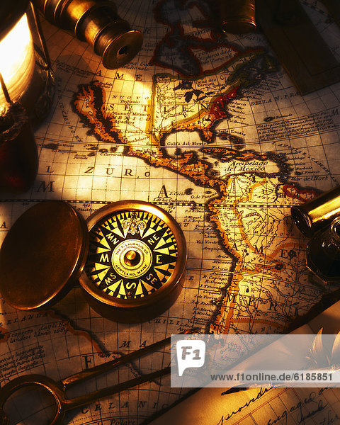 Old-fashioned map and compass