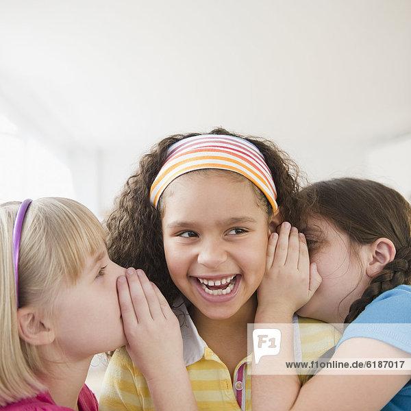 Girls whispering together