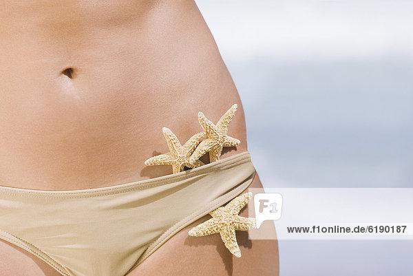 Frau  Bikini  Seestern