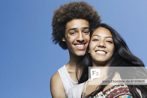 Smiling teenage couple outdoors