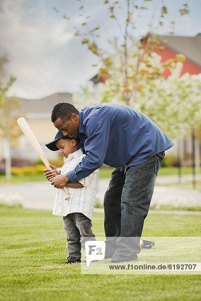 unterrichten  Menschlicher Vater  Sohn  Spiel  Baseball